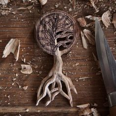 Pendant in progress... This little Oak Tree of Life pendant is still in its early form and elements like the roots will stay a bit chunky until I've finished all of the tiny cut outs between the branches. If I thin them down too much at this point they're likely to snap under the pressure. . . #pendant #talisman #faerie #fae #handcarved #jewellery #handmade #spiritual #woodcraft #oak #carving #rustic #countryside #nature #naturelovers #craftwork #maker #woodcarver  #slowlife #boho #bohemian…