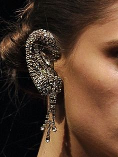 """luxurious"" ear cuff - more like ""make me so disproportionate someone thinks I have a disease"" ear cuff.  Not to mention the amount of annoyance the first time you try to take a call and you scratch the face of your phone on that monstrosity!"