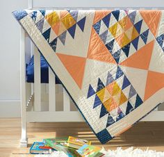 This quilt is a fast, and easy, project - and perfect for using up fat quarters. This Impressionist Sunrise Quilt will fill any room with a flare of color!