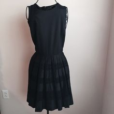 """black dress New with tags, never worn. Great structure. Plain black top with lace detail bottom half. Zip up in back. ❌No Trades or PayPal❌ Quick shipping Offers welcome through """"Make an Offer"""" feature. Ann Taylor Dresses"""