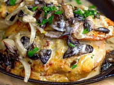 Cheese Stuffed Chicken in White Wine Sauce: Juicy chicken breasts stuffed with a gooey and garlicky cheese filling. Top it all off with a creamy wine sauce!