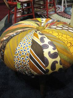 Tada! Here is a great tie project I found at the Urban Mining design booth at the show. Wht a great ottoman...love it!