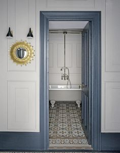 White Bathroom with Chic Floor Tiles and Blue-Grey Woodwork. F&B Hague Blue?