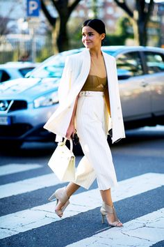 5 Ways To Make A Pantsuit Look Feminine via @WhoWhatWear