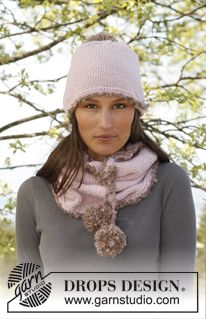 """Candied Pompom - Set consists of: Knitted DROPS hat and neck warmer in """"Nepal"""" and """"Puddel"""". - Free pattern by DROPS Design"""