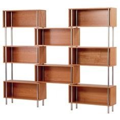 """$1900 available in dark finish      Weight:Measures:  252 lbs74.5"""" H x 94"""" W x 12"""" D  Wood veneer over MDF  Tubular steel frame  Frame is powder-coated in silver  Open design allows for storage space  Shelves are available in maple, graphite-on-oak, or cherry  View the Assembly Instructions"""