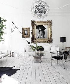 bubble chandelier, picture frames, white wire chair, black chair