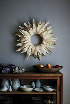 "A Wreath That Gives ""Cornhusking"" a New Meaning - lay flat in middle of table and fill middle with candles, pumkpins, etc."