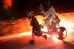 A members of the Haiminger Krampusgruppe pulls another on a fiery cart to the town square during the annual Krampusnacht in Haiming, Austria, on December 1, 2013.