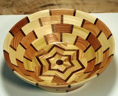 Segmented Bowl, Red Oak, Poplar, & Walnut with 6 star bottom  146 pieces, lots of cutting & gluing. Lot of work in this segmented stuff. Find it.  Etsy.com - TedsWoodworks
