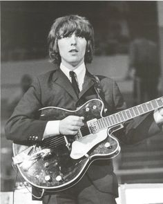 Google Image Result for http://images2.fanpop.com/images/photos/7700000/George-Harrison-the-beatles-7756009-598-748.jpg