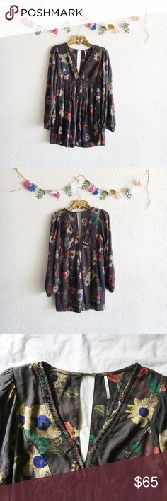 """Free People Floral Long Sleeve Dress Gorgeous floral long sleeve dress with a deep v-neck and ladder cutouts from Free People. Lined and has pockets! A great piece for the fall season! Size XS.   Approximate Measurements (laying flat):  • length: 30.5""""  • underarm to underarm: 17"""" Free People Dresses Mini"""