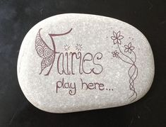 """Fairies play here"" written on a stone:"