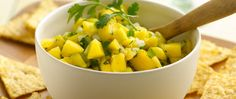 Enjoy this savory cucumber and mango salsa served a with tortilla chips.