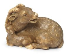 An ivory netsuke of a stag and young By Okatomo, Kyoto, late 18th/early 19th century; sold 26,698 USD; 10/05/17.