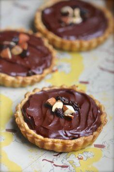 Little chocolate tarts inspired by the Cadbury Fruit and Nut candy bar.  #ganache #raisins #almonds