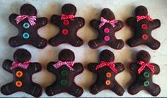 Ginger bread men. Made with felt ready for hanging on the tree.  By Jannette Winstone