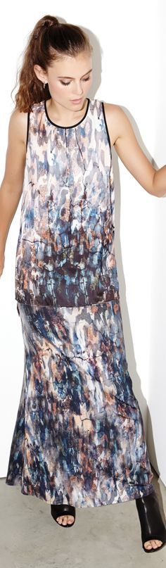 A splashy painterly print highlights the sleeveless silhouette of this Karen Kane tank detailed with a deeply-cut keyhole at the back.
