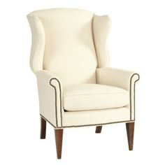 Helmes Wing Chair- in May 2013 BH covered with Indochine Ikat Bark fabric with nailhead detail and parchment legs