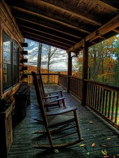 A rocking chair on a log cabin porch with a magnificent view of the mountains.  Yep...pretty gosh darn happy!!
