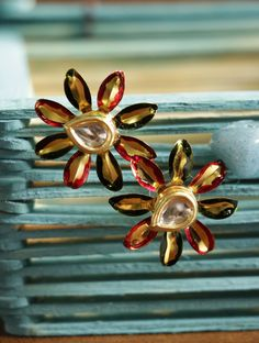 Designer earrings collection for women and girls online at Styyo jewellery store.