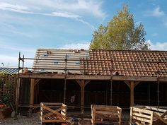 Car barn in recailmed clay tiles for evoplain roofing Car Barn, Clay Tiles, Cabin, House Styles, Outdoor Decor, Home Decor, Decoration Home, Room Decor, Cabins