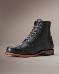 <p>A southerner with Irish roots, the Arkansas Brogue is dressed in full grain leather with every hallmark and historic detail. Perforated trim, cleanly capped toe and waxed laces, all the way up. Made in the USA.</p>