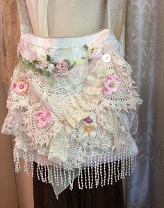 Gorgeous doily purse handmade shabby romantic style with layered laces and doilies. The body of this fabric purse is overall white with a splash of color. The crocheted doily on the front has an ivory, off-white color. The base fabric is a thick, sturdy vintage tablecloth fabric. I