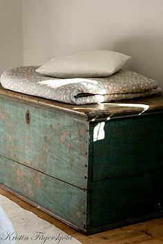Trunk next to couch or at the foot of a bed for extra blankets and pillows.+++ 2 of these near front door with wall coat rack above.