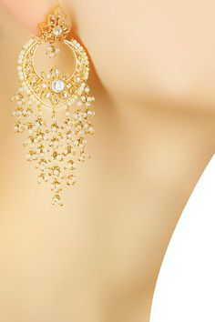 Gold finish kundan and pearl bunches earrings available only at Pernia's Pop Up Shop.