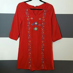 """Vibrant red Aztec print tunic dress NWT Brand new, tag attached  Gorgeous vibrant red tunic dress with Aztec threaded print on the front.  Size small Length approx 33"""" 3/4 sleeve with elastic at the ends Scoop neck Multi color print 100%polyester Dresses"""