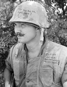 A member of the 3rd Marines decorated both his helmet and his flack jacket (GYSGT Gus Apsitis/Marine Corps/National Archives).