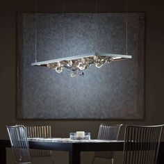 Hubbardton Forge winter pendant light, this is stunning, its very similar to one I saw in the pier one catalogue with Garland and lanterns on the top.  Aff