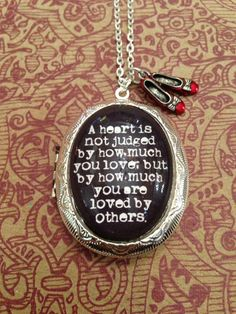 I want this! Wizard of Oz Quote Locket Necklace A Heart is Not Judged by How Much You Love on Etsy, $26.00