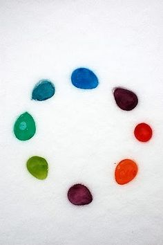 Colored ice outdoor decorations - balloons filled with a drop of food coloring and water that has been frozen.