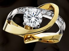 Aurum two tone modern engagement ring...would be prettier with rose gold
