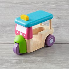 Plan Toys Tuk Tuk Vehicle.  This auto rickshaw (Tuk Tuk) is a common mode of transportation in many countries.