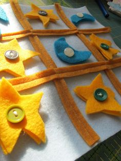 Tutorial: Felt Tic-Tac-Toe Boards. I will do mine a little different. I will sew down the strips and stuff the stars and half moons