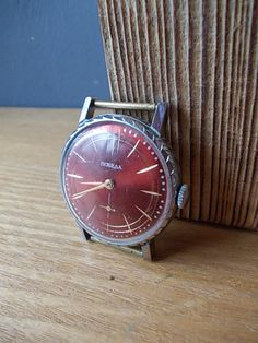 Rare vintage men watch POBEDA , in good working condition with gilded parts. Made in USSR 70s.  Mechanical movement, manual winding.   Great collectible item or gift.  1 3/8 in diameter  This is the mechanical watch that uses mechanical mechanism to measure the passage of time and no battery required.  You are welcomed to visit my shop section Vintage for other watches: https://www.etsy.com/shop/EUvintage?section_id=13110312&ref=shopsection_leftnav_1  Yo...