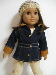 This is the perfect outfit for a Saturday Stroll in the fall leaves for your American Girl! What you get... The Coat...Denim Le Maris Coat made with the Liberty Jane Pattern. It has leather collar and cuffs for some extra Trendiness. It is fully lined with a Giraffe print fabric. It closes with velcro and has faux gold snap detail on the front and back. The Hat. ... A hand knit slouch hat in a gold yarn with navy stripes. The T-Shirt... an ivory cotton knit with metallic gold allo...