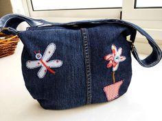 Cómo transformar unos jeans en una bolsa para tu portátil | Aprender manualidades es facilisimo.com
