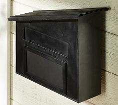 Nice, fun design for a wall mount mailbox, complete with two slots.  One for mail and one for packages.