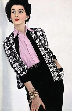Dovima in a lovely mix of pink, white, and black in this, causal daywear look from 1952
