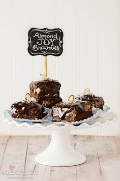 Almond Joy Brownies - Fudgy almond brownies, topped with sweet, creamy coconut filling and whole, crunchy almonds, and covered in rich dark chocolate ganache