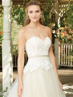 A perfect sweetheart neckline and straight across back frame the drop waist silhouette of this bodice, which is constructed from beaded lace. Beneath, layers ...