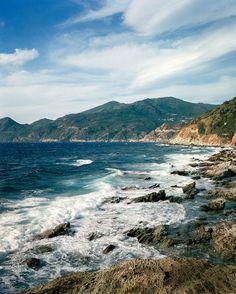 Into the Blue - A rocky beach near the small Corsican village where the StudioKO designers have a home  Sittings Editor: Miranda Brooks