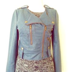 Blue Urban Outfitters (Jack) studded moto jacket Cropped faux leather Urban Outfitters by Jack moto jacket in a slate blue color with semi-matte gold stud and zipper accents. Front has 2 zipper pockets & 1 non zip pocket. Flattering jacket worn very little. Very minor wear, a small loose thread in back where the middle pleat in the jacket is that is very hard to notice (see photos, but note color in photo #4 is lighter and much more gray than the actual jacket because of how close pic had to…