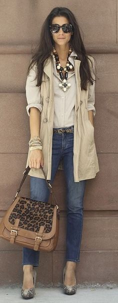 Sleeveless long jacket over blouse over medium wash denim with chunky statement necklace, glitter pumps and leopard print bag.