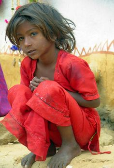 Jaisalmer , Rajasthan . Malcolm Arnold little girl in red--always a favourite of mine