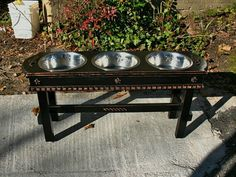 Dog food bowls elevated - love the look but they need to be lower for our puppies.